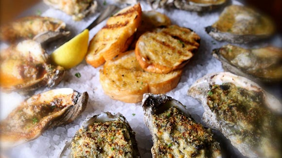 The oyster sampler at Half Shell Oyster House includes four varieties of the restaurant's specialty.