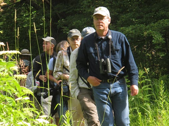 Noted author and illustrator David Allen Sibley leads a morning walking tour with fellow birders last summer at the Green Mountain Audubon Center in Huntington.