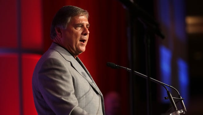 U of L athletic director Tom Jurich during the Kickoff Luncheon at the downtown Marriott on Thursday. Aug. 14, 2014