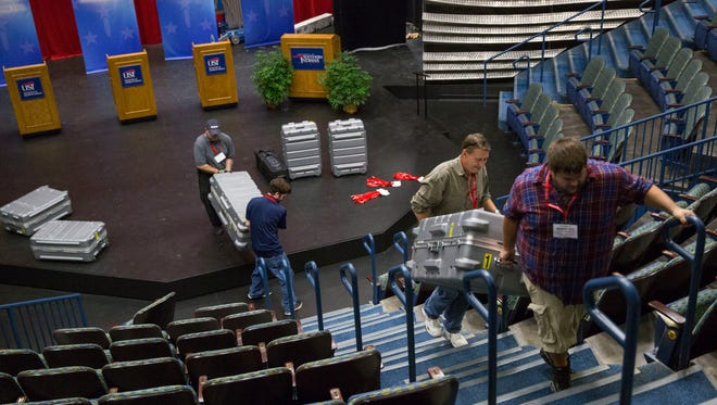 WFIE staff members, from right, Riley Fugate, Chuck Summerville, Justin Newman and Tom Gore, hall cameras up to the balcony to set up on Monday morning for the Gubernatorial Debate at USI. The debate will be televised from the Performance Center at USI on Tuesday, Oct. 25, 2016 at 6 p.m. CST.