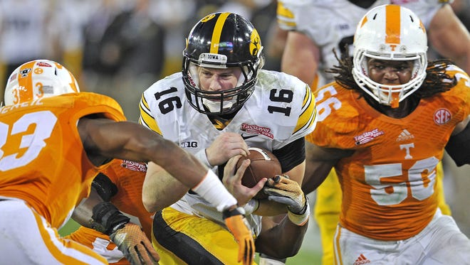 Iowa quarterback C.J. Beathard took a beating against Tennessee on Jan. 2 but piled up more impressive numbers than Jake Rudock.