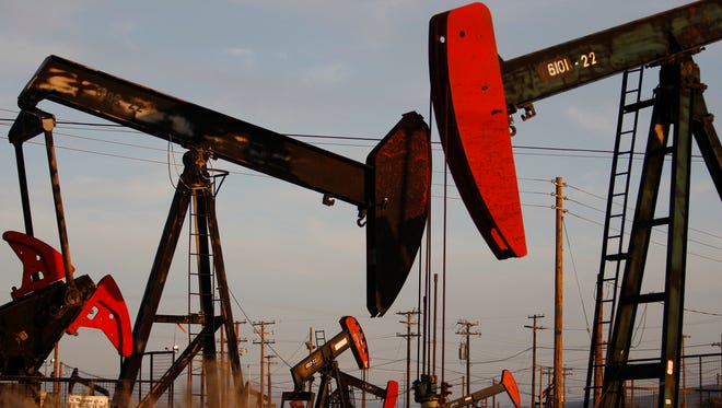 Pump jacks and wells are seen in an oil field on the Monterey Shale formation where gas and oil extraction using hydraulic fracturing, or fracking, on March 23, 2014 near McKittrick, California.