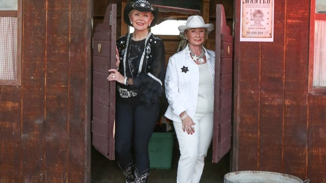 Denim to Diamonds Co-Chairs Nancy Stone and Marge Barry hit the saloon before the party starts.
