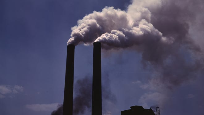 Smokestacks spew greenhouse gases into the air—a practice that California hopes to constrain with its cap and trade system