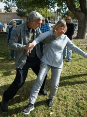 """Steve Barowsky, tai chi instructor, explains a tai chi move with help from Jeanne Rundell during a tai chi class at the park next to the Mesilla Park Recreation Center, Thursday Nov. 10, 2016. Tai chi is a type of martial arts practice for a more """"internal"""" purpose."""