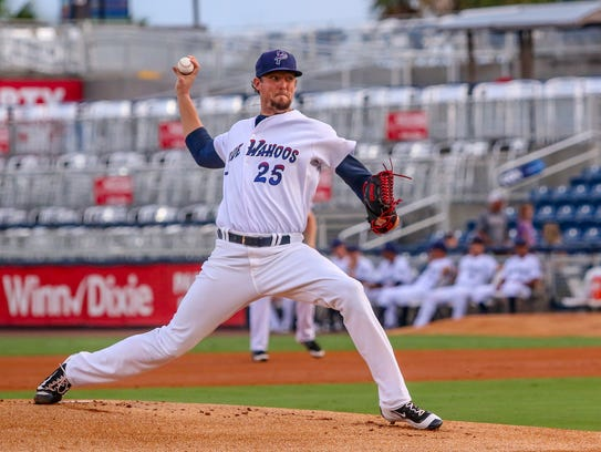 Blue Wahoos pitcher Deck McGuire throws against the