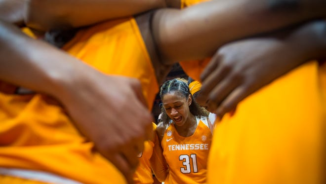 Tennessee guard Jaime Nared (31) leads her team in prayer after an 82-75 win against Texas on Sunday at Thompson-Boling Arena.