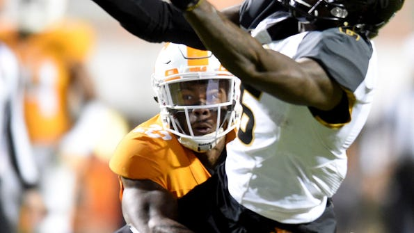 Missouri wide receiver J'Mon Moore reaches for a pass with Tennessee defensive back Cameron Sutton (23) defending during the second half of an NCAA college football game, Saturday, Nov. 19, 2016 in Knoxville, Tenn. (Caitie McMekin/Knoxville News Sentinel via AP)