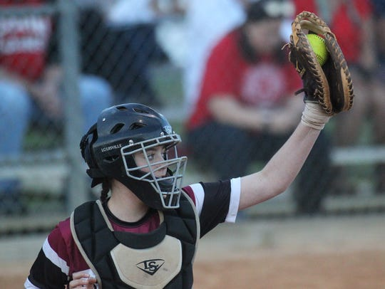 Chiles catcher Haley Bond brings in a high pitch.