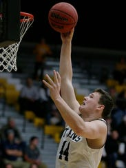 UW-Oshkosh's Jack Flynn goes up for a shot against UW-Whitewater during a Jan. 3 game.
