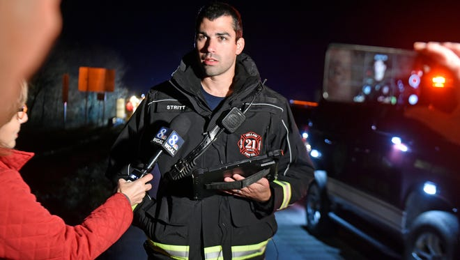 Hellam Fire Company Chief Eric Strittmatter speaks to the media after a crash involving the Eastern York football team tour bus in the eastbound lanes on Rt. 30 early Saturday morning, which killed the woman driving the SUV that struck the bus head-on.
