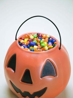 Sweets in Halloween lantern.