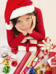 Woman ponders wrapping gifts