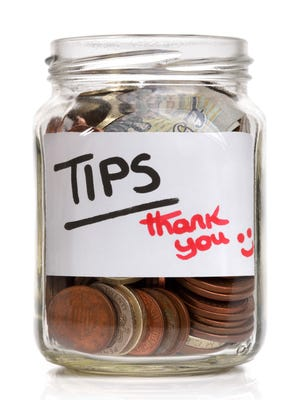 Tipping at the end of the year is an accepted custom for many service industries.
