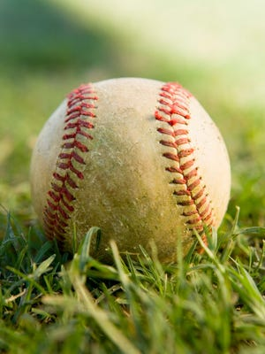 Baseball Sitting on Grass