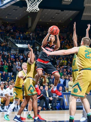 Louisville Cardinals guard Quentin Snider (4) goes up for a shot as Notre Dame Fighting Irish guard D.J. Harvey (3) defends in the first half at the Purcell Pavilion in South Bend, Indiana, on Tuesday, Jan. 16, 2018.