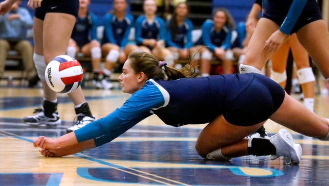 Siegel volleyball standout Makenzie Jordan dives for a save during a 2017 match. Jordan recently committed to play at Mississippi State.