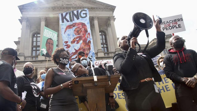U.S. Rep. Erica Thomas , D - Austell, speaks as she joined with members of the Georgia Democratic caucus on the steps of the Capitol Monday, June 15, 2020 in Atlanta. The NAACP March to the Capitol coincided with the restart of the Georgia 2020 General Assembly. Lawmakers returned wearing masks and followed new rules to restart the session during the pandemic.