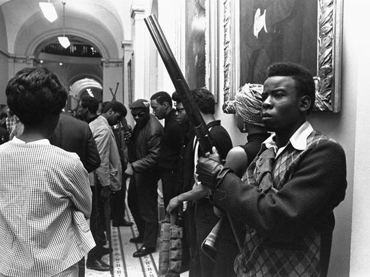 Armed members of the Black Panthers Party stand in the corridor of the Capitol in Sacramento, Calif., on May 2, 1967. They were protesting  a bill before an Assembly committee restricting the carrying of arms in public.