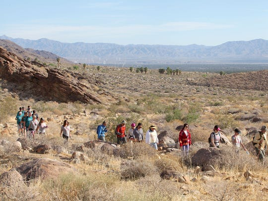 A group hikes in the Indian Canyons during the Richard M. Milanovich Legacy Hike, May 6, 2016.