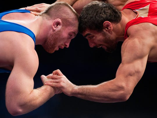 Kyle Snyder of the United States (blue) battles against