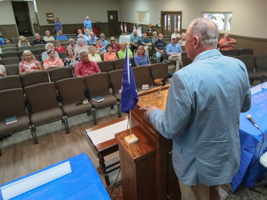 Anderson County Council members Tommy Dunn lets the crowd know he is against a proposed 2 percent hospitality tax, held at Concord Community Church in Anderson.