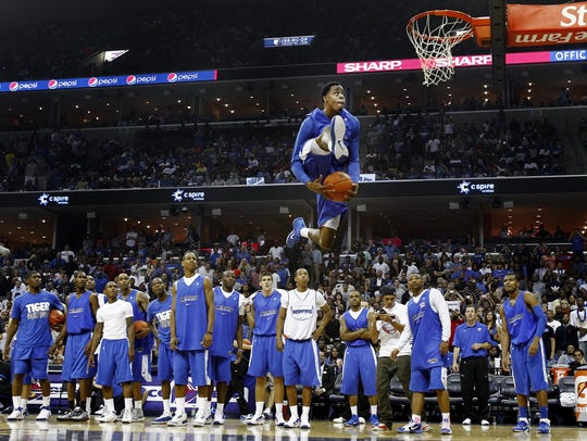 Memphis' D.J. Stephens (top) skies for a dunk as his