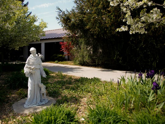 A statue of St. Francis of Assisi welcomes worshippers