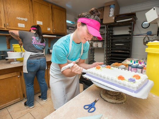 "Julia Atabey, right, decorates a cake at the Milton Quality Bakery in Milton on Monday, May 14, 2018.  The bakery, which is competing in the ""Sweetest Bakery in America Contest"", currently has the second most votes in the state of Florida."