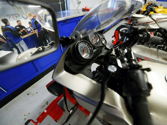 A class is reflected in a motorcycle mirror at the YTI Career Institute's motorsports technology program in Manchester Township. May is Motorcycle Safety Month, and there are a number of things you can do to get ready for the riding season.