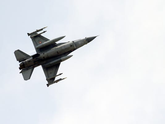A missile-loaded Turkish Air Force warplane takes off Tuesday from the Incirlik Air Base, in the outskirts of the city of Adana, southeastern Turkey.