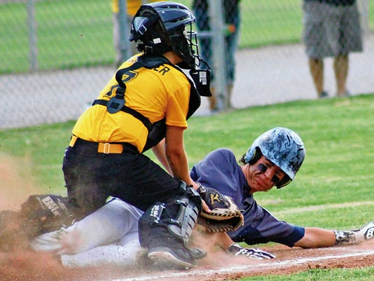 Peyton Hightower tags out a Ruidoso player at home plate Wednesday evening at the Griggs Sports Complex.