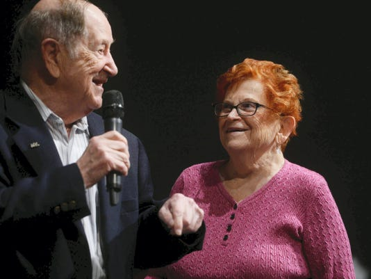 Rubin Sztajer, a Holocaust survivor, jokes with his wife, Regina Sztajer, as he speaks to students about his experience for National Day of Remembrance at Dallastown Area High School Thursday.