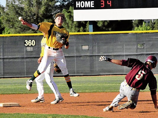 Jaime Guzman/For the Sun-News   Mayfiled shortstop Ethan Alvarado gets ready to turn a double play as Gadsden's Andrew Salinas tries to break up the attempt.