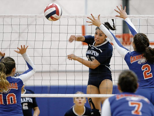 MARK LAMBIE-EL PASO TIMES  Chapin's Alyssa Lozoya threads the ball between Canutillo's Lauren Hernandez, left, and Danielle Quintanar during their match Tuesday at Canutillo High School.