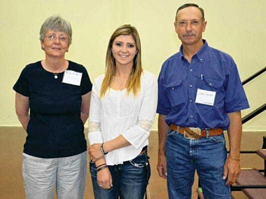 Courtesy Photo   Kalyn Hazen, center, receives the 2015 New Mexico Wool Growers Inc. (NMWGI) college scholarship from Sarah Gnatkowsk and NMWGI Past President Jim Cooper. Hazen, a 2015 Capitan High School graduate, plans to attend NMSU and study Animal Science.