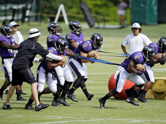 Baltimore Ravens' running back Justin Forsett (29) and fullback Kiero Small (35) run a drill with teammates during training camp Thursday in Owings Mills, Md.