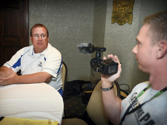 Lampeter-Strasburg coach John Manion is interviewed by GameTimePA reporter John Buffone during media day activities on Friday.