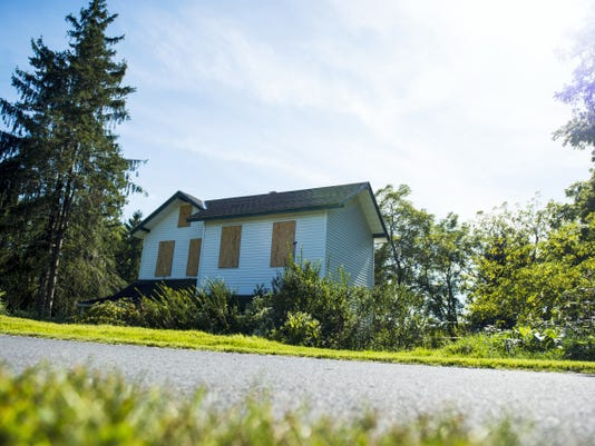 Dr.Tammy Stone plans to construct a veterinarian clinic on land adjacent to the Lebanon Valley Rail Trail, behind Lebanon Fire Station No. 1 on Orange Street. Her plan calls for demolishing the vacant house. Jeremy Long -- Lebanon Daily News