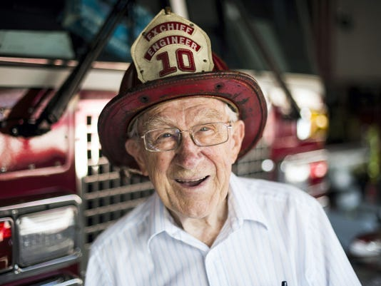 Phillip Mohn, 89, who served 67 and a half years with Jonestown's Perseverance Fire Co. poses Friday with the helmet he wore while on duty in 1967.