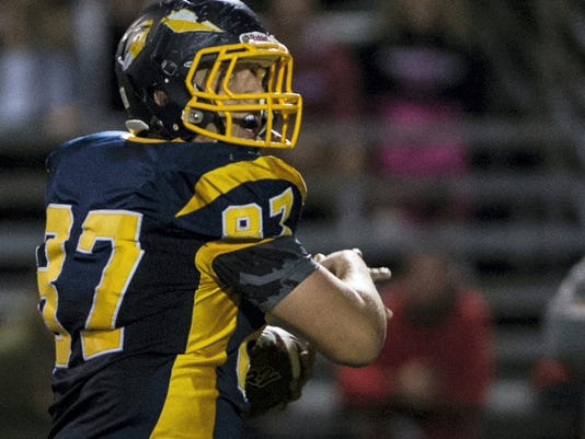 Elco senior Dylan Stoops looks over his shoulder as he runs to the end zone for a touchdown during the Raiders' 28-14 comeback win over Pequea Valley on Friday.