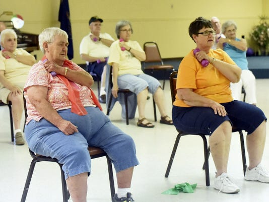 Seniors work with light weights during an exercise class on Thursday at the Tuscarora Senior Enrichment Center. The center's activities are becoming more popular as more and more baby boomers reach their golden years.
