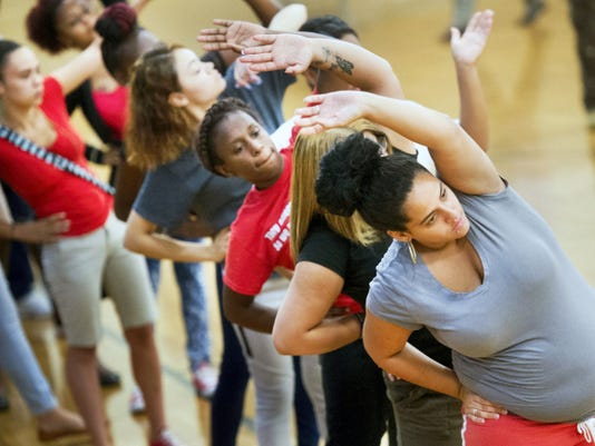 Jocelyn Delgado, right, leads a line of students performing drills during a mini-mental toughness drill preformed before school at Crispus Attucks Tuesday. The students are put into squads to motivate each other to come to school so they can get rewards.