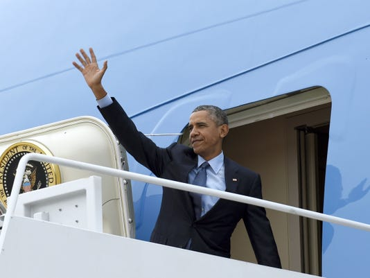 President Barack Obama waves from the top of the steps of Air Force One at Andrews Air Force Base in Maryland, Monday, Nov. 2, 2015. Obama is traveling to Newark, N.J., to visit a drug treatment center and aims to boost his ongoing push for overhauling the criminal justice system. (AP Photo/Susan Walsh)