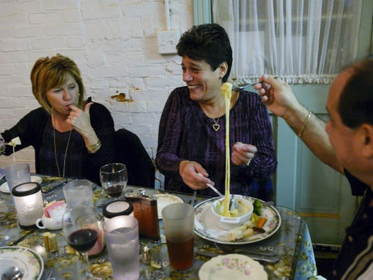 Joe Monti, right, of Windsor Township, lifts a dipped vegetable to stretch out the cheese fondue as his wife Jean and friend Deb Smith, left, watch during a four-course Chef's Table dinner at Red Brick Bakery and Tea Room in Red Lion on Saturday, Oct. 18, 2014. Chris Dunn — Daily Record/Sunday News