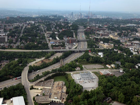 AERIAL-LOCAL: Tuesday July 8, 2014: An aerial view Martin Luther King Drive, middle, where it crosses I-71. A new interchange is scheduled for construction to begin this summer. The project is budgeted for $108 Million.  The Enquirer/Glenn Hartong. gh