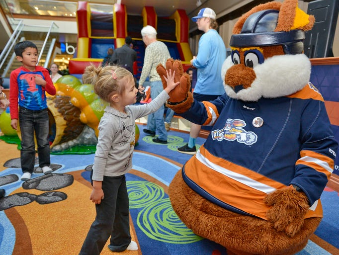The Greenville Swamp Rabbits mascot, Stomper, plays