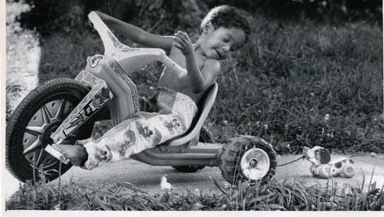 Darren Rucker, 3 years old, checks out his passenger