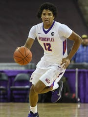 University of Evansville's Dru Smith (12) dribbles down the court as his team takes on the Bradley Braves in the first half at the Ford Center in Evansville, Ind., Saturday, Jan. 6, 2018.