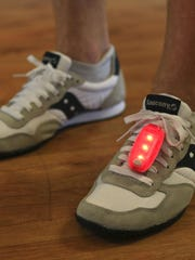 Clip-on lights can be worn on the top of running shoes or the waistband for more visibility to motorists. Price is $10 at Fleet Feet Sports. July 9, 2015
